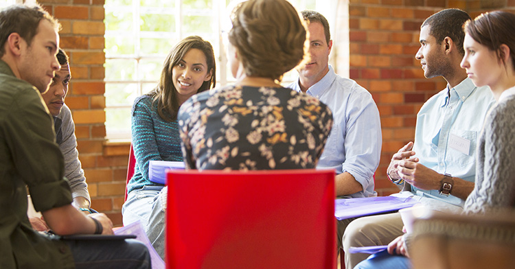 Psychotherapist leading a Group Therapy Session
